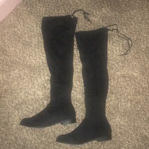 Thigh high flat boots